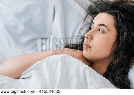 Morning Melancholy. Weekend Loneliness. Home Depression. Pensive Tired Sad Brunette Woman Lying In B