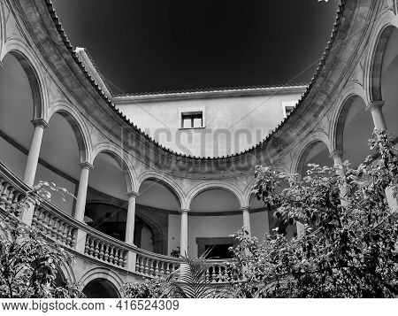 Round Spanish Patio With Arcade Gallery And Colonnade