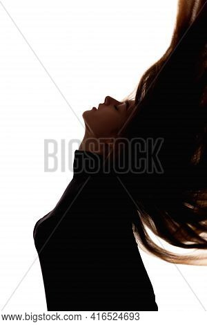Beauty Silhouette. Haircare Treatment. Keratin Therapy. Dark Contrast Profile Outline Portrait Of Br