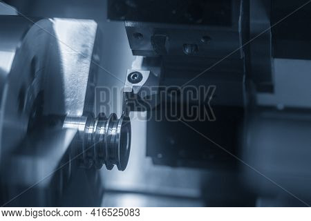 The  Cnc Lathe Machine Groove Cutting The Pulley Parts. The Hi-technology Metal Working Processing B