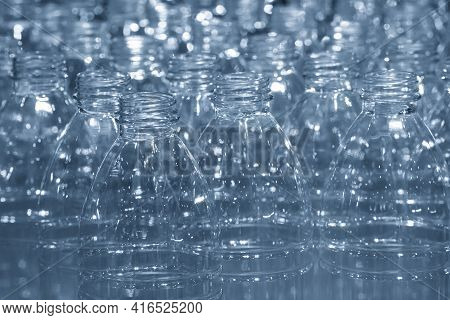 The Pet Bottles  On The Conveyor Belt For Filling Process In The Drinking Water Factory. The Hi-tech