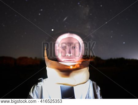 Close Up Portrait Of Astronaut Explorer And Spaceman In White Suit And Transparent Helmet On Starry