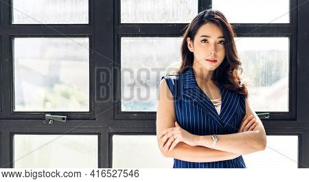 Beautiful Smiling Confident Asian Businesswoman In Smart Casual Looking At Camara.young Creative Cow