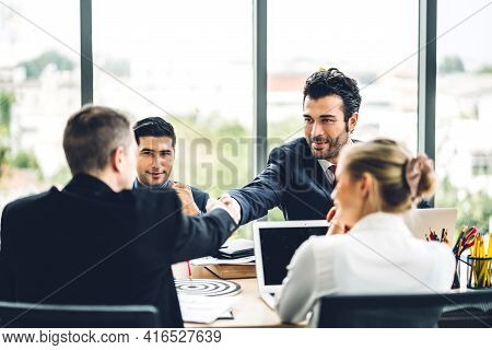 Image Two Business Partners Successful Handshake Together In Front Of Teamwork Casual Business Winni