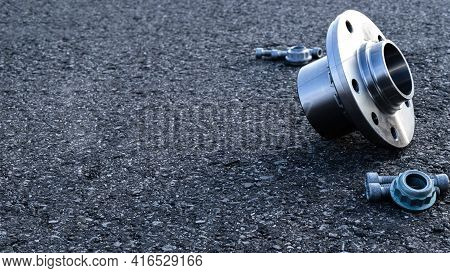 Vehicle Parts. Auto Motor Mechanic Spare Or Automotive Piece On Dark Road Asphalt Background. Tarmac