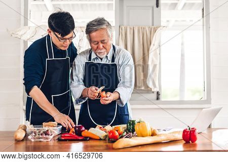 Portrait Of Happy Love Asian Family Senior Mature Father And Young Man Adult Son Having Fun Cooking