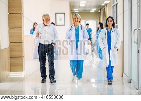 Group Of Professional Medical Doctor Team With Stethoscope In Uniform Working Discussing And Talk Wa