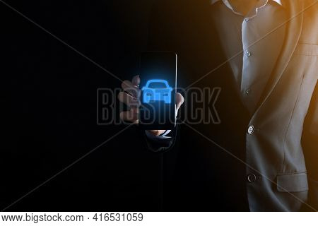 Digital Composite Of Man Holding Car Icon.car Automobile Insurance And Car Services Concept. Busines