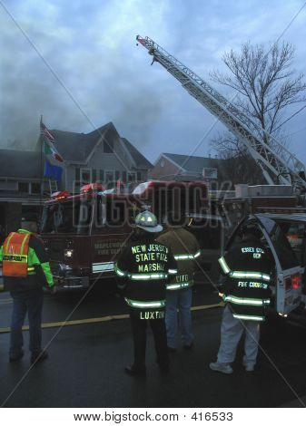 Firemen And Firetruck At House Fire