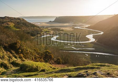 View Of Three Cliff's Bay And Penard Pill River At Sunset In Spring, Gower, Swansea, South Wales, Uk