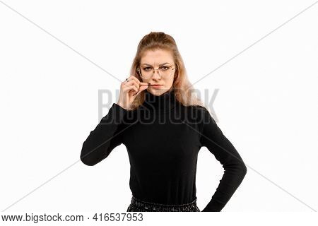 Serious Young Woman Zipping Her Mouth Shut, Show Taboo Hush Gesture And Frowning, Be Quiet, Standing