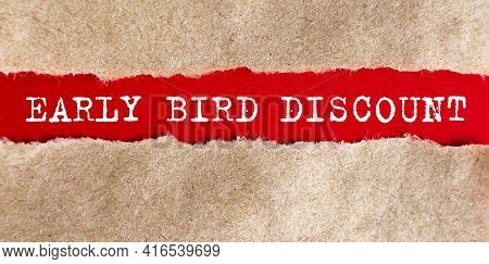 Early Bird Discount Appearing Behind Torn Paper.business Concept