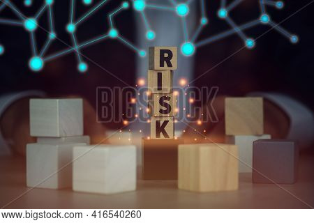 Wooden Blocks With Teh Word Risk With Fantasy Background. Executive And Risk Control Concept And The