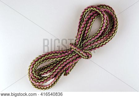 Universal Polypropylene Rope On A Neutral Background. A Coil Of New Colored Rope. View From Above.