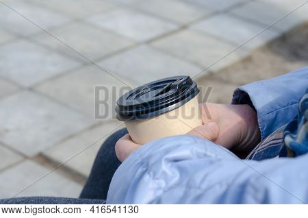 Close-up Of A Females Hands With A Bamboo Coffee Cup With Lid. Adult Women Holding A Brown Cup With