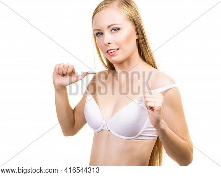 Young Slim Woman Holding Bra Strap. Straps Keep Falling Down Problem. Female Breast In Lingerie. Bos