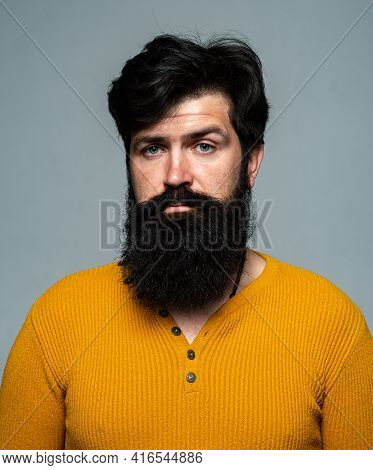 Barbershop Man Beard And Moustache. Handsome Bearded Male Guy On Grey Background Looking At Camera