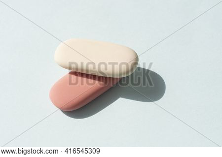 Colorful Rubber Erasers On A Blue Background.