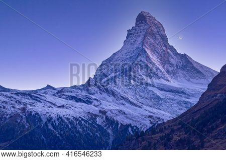 Matterhorn Mountain Snow Peak, Swiss Alps, Zermatt, Switzerland At Dusk And Crescent View