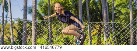 Banner, Long Format Young Woman On A Soft Board For A Trampoline Jumping On An Outdoor Trampoline, A