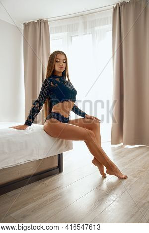 Side Full Length View Of Sexy Woman Posing On Bed Near Window, Perfect Muscular Body. Young Female M