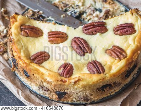 Cheesecake With Pecan Nuts On Parchment Paper, Top View.