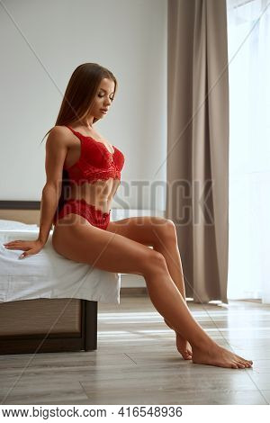 Side Full View Of Sexy Woman Posing On Bed Near Window In Bedroom, Perfect Muscular Body. Young Fema