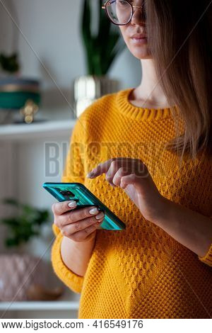 Woman Using Mobile Phone, Holding In Hands