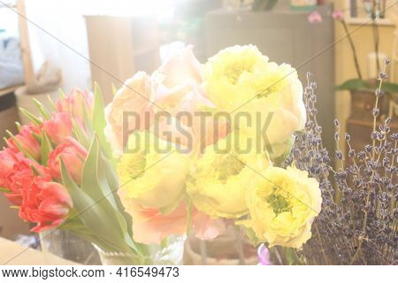 Selective Focus. Green Eye Roses, Red Tulips And Lavender In The Sun. Florist Desk, Florist Workshop