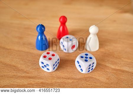 Dice And Game Pieces Of Different Colors. Collection Of Dice Cubes On A Wooden Table