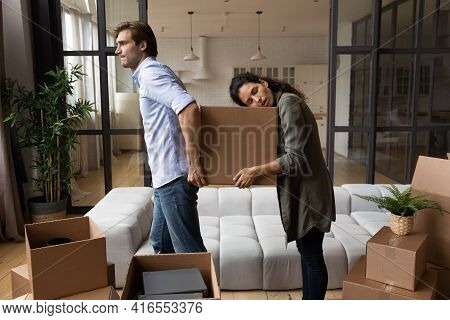 Tired Couple Carrying Cardboard Box, Relocating To New Apartment