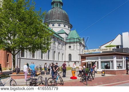 Haren, Germany - May 09, 2020: People Standing In Line For Ice Cream At The Historic Dom Church In H