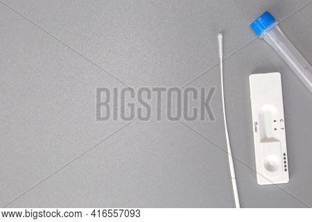Rapid Self Test Covid-19 With Nose Swab, Home Test Kit For Coronavirus Top View On Gray Background W