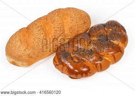 Whole Loaves Of Wheat Bread Sprinkled With Sesame Seeds Before Being Baked And Sweet Braided Bread S