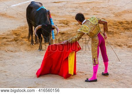 MOITA LISBON, PORTUGAL - SEPTEMBER 14: Matador and bull in tourada bullfight on September 14, 2016 in Moita Lisbon, Portugal.