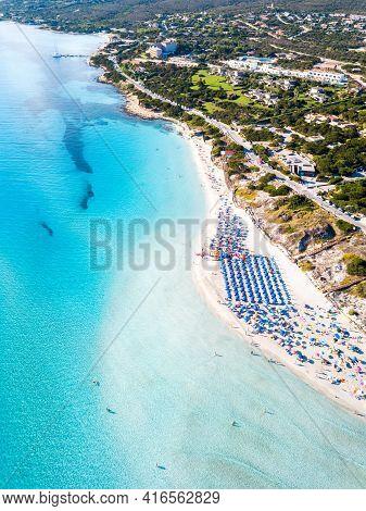 Mediterranean Beach La Pelosa, Stintino, Sardinia Island, Italy. Aerial View In The Morning