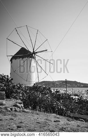 Windmill on the coast. Black and white photography, landscape. Mykonos island , Greece