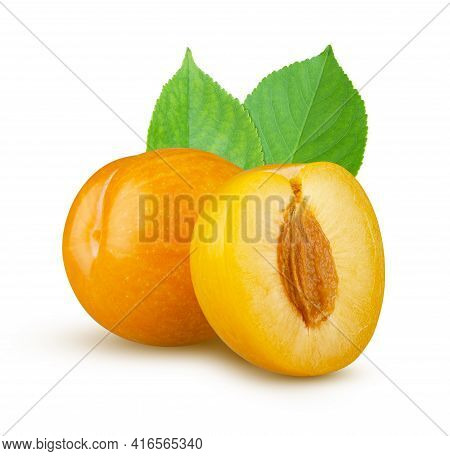 Yellow Plums Whole And Half With Leaves Isolated On White. Excellent Retouching And High Resolution.
