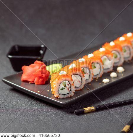 California Unagi Sushi Roll With Soya, Wasabi, Ginger And Black Chopstick