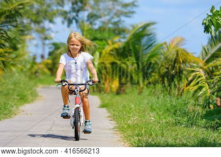 Country Cycling Walk. Young Rider Kid Riding Bicycle. Happy Child Have Fun On Field Trail. Active Fa