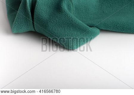 Green Cloth On White Background. Textile Sewing. Fleece Fabric Folded.