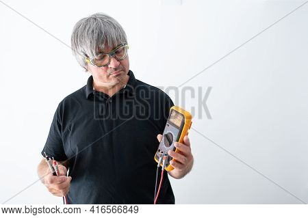 Professional Electrician Holds In His Hands A Poly Meter, Isolated On A White Background.copy Space