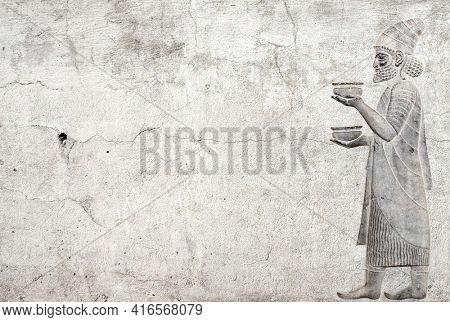 Ancient wall with bas-relief with foreign ambassador with gift and donations, Persepolis, Iran. Horizontal background with embossed image persian bearded man. Mock up template. Copy space for text