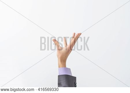 Mans Hand In Suit Begs To Something Isolated On White Background. Palm Up, Close Up. High Resolution