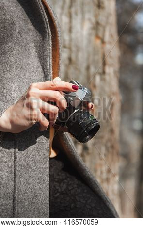 Old Vintage Camera Rangefinder In The Hands Of A Girl Who Is In The Park
