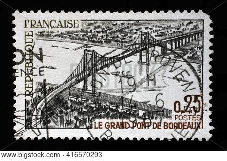 ZAGREB, CROATIA - SEPTEMBER 09, 2014: Stamp printed in the France shows image of The great bridge of Bordeaux or Pont d'Aquitaine, Tourism series, circa 1967