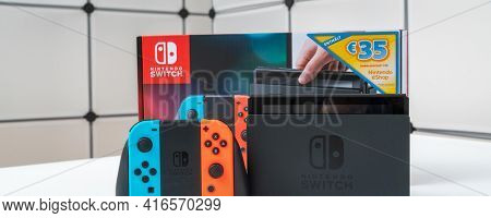 Nintendo Switch video game console developed by Nintendo, on a white background. Germany, Berlin - June 30, 2019: Nintendo Switch Joy-con controller on a white background