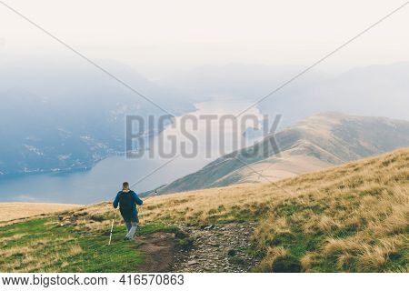 Man Is Highting With Fog Misty View Mountains And Lake Landscape. Summer Vacations Outdoor. Trekking