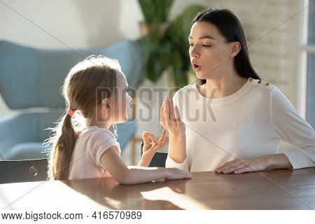 Little Girl With Mom Learn Pronouncing Sounds