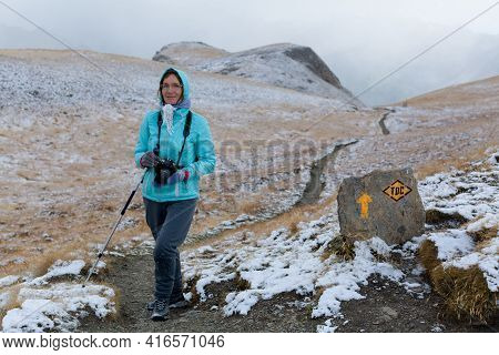 Solo Traveling Mature Woman Hiking With Backpack In Mountains Adventure Journey Lifestyle Vacations